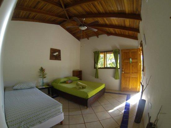 Indra Inn: Wood Bedroom