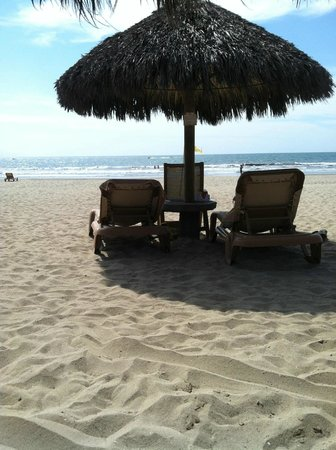 Paradise Village Beach Resort & Spa:                   The lounge chairs and umbrella on the beach