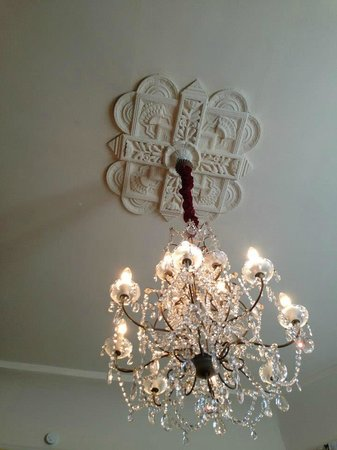 Sully Mansion Bed and Breakfast:                   Beautiful Chandelier in Dining Room
