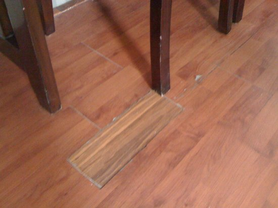 Standford Suites Hotel:                   Patched up wood floor