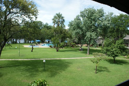 A'Zambezi River Lodge:                   View from room of pool area leading to Zambezi River