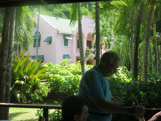 La Sagesse Hotel, Restaurant & Beach Bar:                   Sitting in the bar looking at the main house