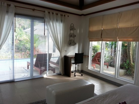 Bangtao Beach Chalet:                   master bedroom looking out to the pool