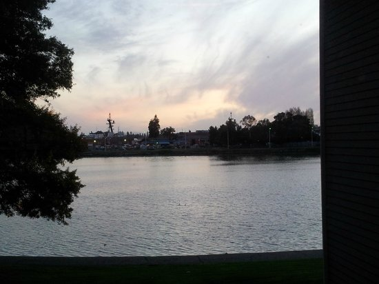 Executive Inn & Suites:                                     a picture of the sunsetting on the cove from the hallway win