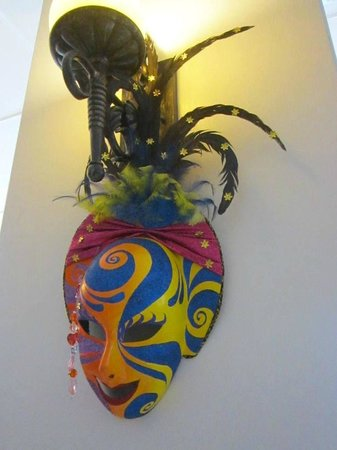 The Inns Bacolod by The Oriental:                                     Hotel decorated with masks
