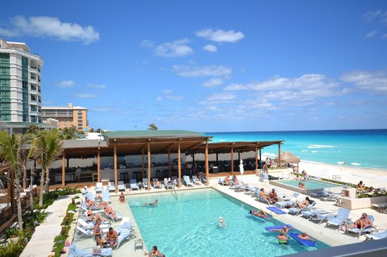 Secrets The Vine Cancún:                   North east view of the resort, hot tub, bar, sea salt grill, pool view