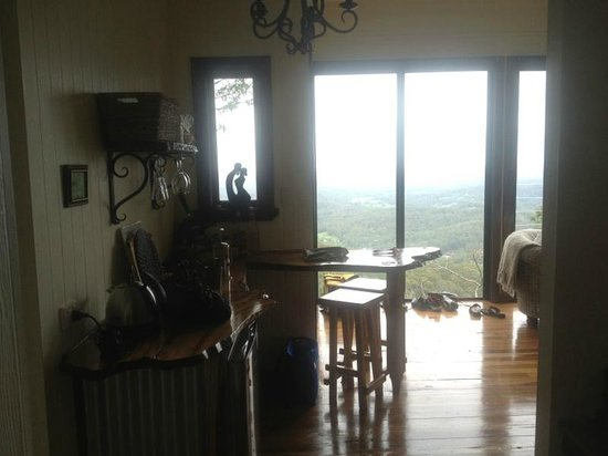 At Remingtons Lodge & Private Cottages:                   the view from front door, breaky bench on (L) to the view.
