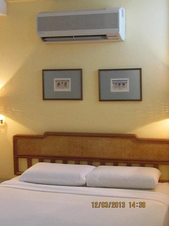 Perak Hotel:                   double bed with aircon above