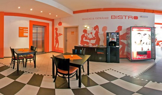 Orange Hotel und Apartments : Bistro