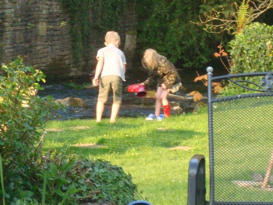 Watermill Cottages: playing in the stream