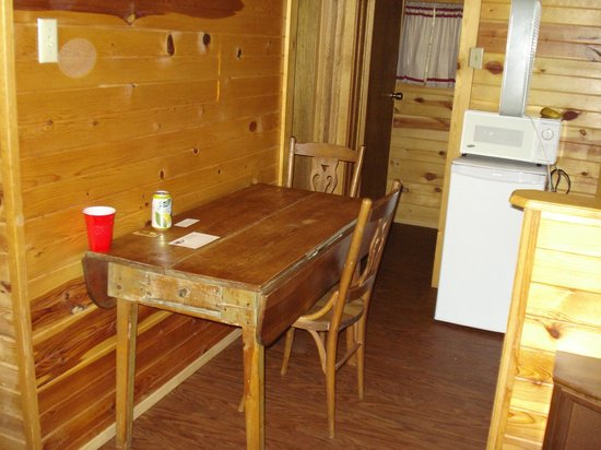 Shady Rest Motel:                   Kitchen table Cabin #6 and bathroom door behind that.