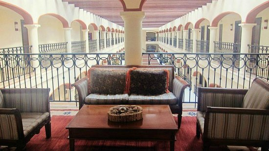 Secrets Capri Riviera Cancún:                   Sitting area in the hallway by the room
