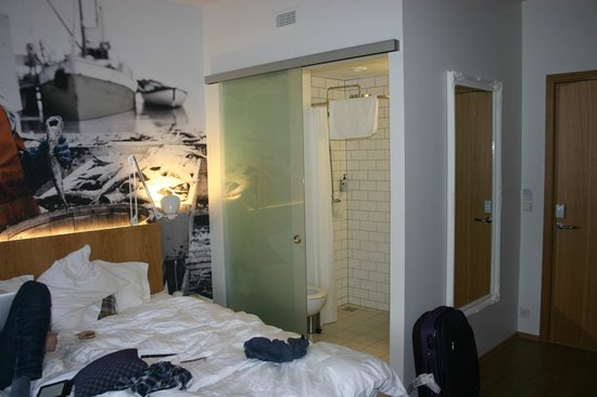 Icelandair Hotel Reykjavik Marina :                   Bedroom - see the sliding door not offering much privacy for the loo!