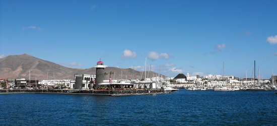 Hotel THe Volcan Lanzarote:                                     Marina Rubicon with Hotel Volcan just right of centre