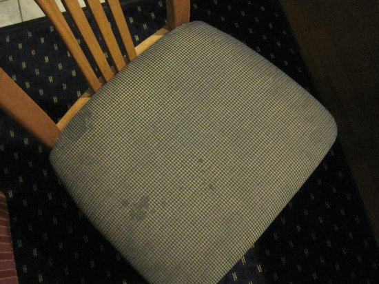Gatehouse Suites East Lansing:                   Disgusting kitchen chair 2