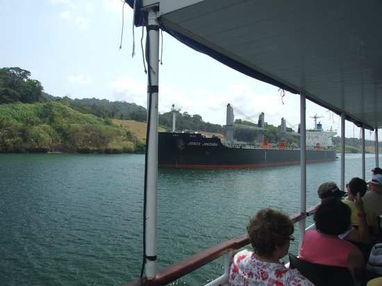 Canal de Panamá:                   A ship coming down the canal beside our tour boat.