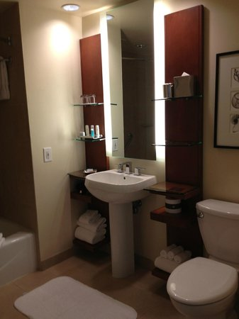 Omni San Diego Hotel: Awkward bathroom set up for two.  Small glass shelves from which your belongings slide off.