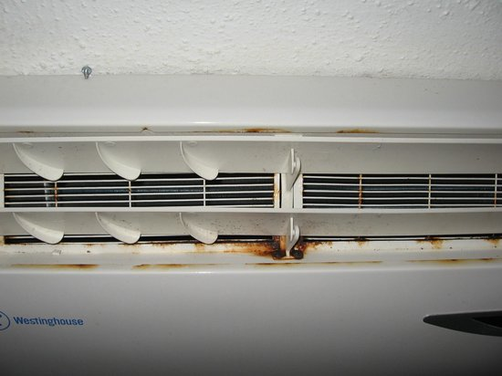 Coral Costa Caribe Resort & Spa:                   Rusty air conditioner in room