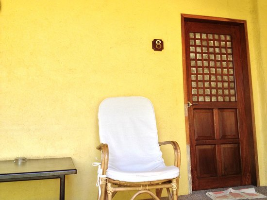 Hibiscus Garden Inn:                   Lounge Chair outside the room