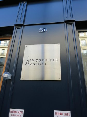 Hotel Atmospheres:                   Hotel Logo at Front door