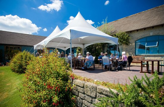 The Oak Room Restaurant - Dainton Park: A large terrace overlooking the 18th green is ideal for an aperitif