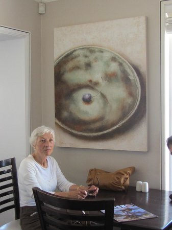 Savannah Cafe:                   My Mom at our table with one of those beautiful paintings behind her
