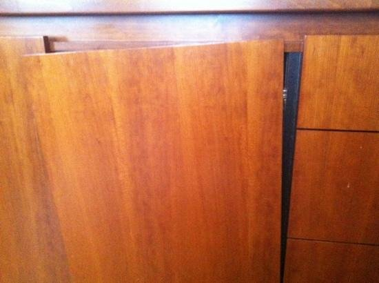 La Bergere Apartments:                                                       the cupboard door that fell off onto my fo