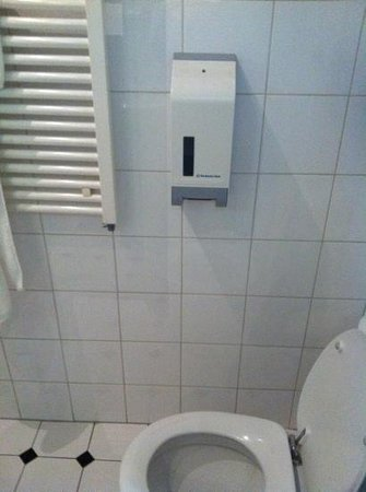 La Bergere Apartments:                                     one of the many unused dispensers on the bathroom wall