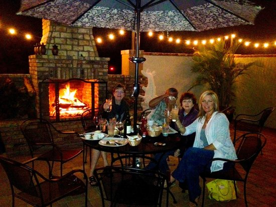 The Grille at the West Beach Hotel & Resort :                                                       Outdoor Fireplace