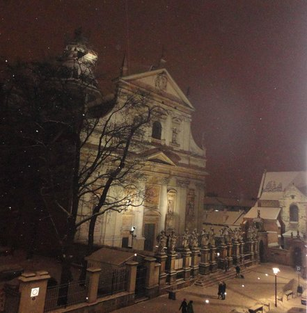 Hotel Senacki:                   Church at night in the snow.