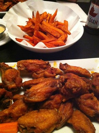 Tee Jay's Sports Grill :                                                       sweet potato fries and NY Butter wings (ab