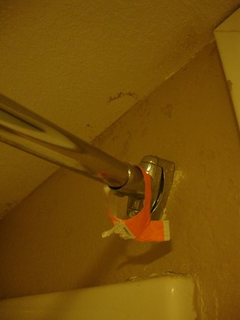 Super 8 San Antonio/Downtown Riverwalk:                   Moldy ceiling, and someone's old bracelet on shower rod.