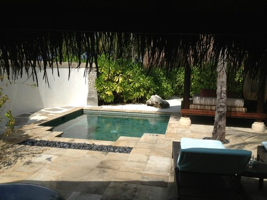 Four Seasons Resort Maldives at Kuda Huraa:                   private bungalow pool and lounge area