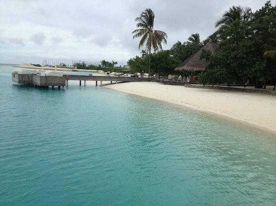 Four Seasons Resort Maldives at Kuda Huraa:                   view of the sunset lounge from the boat dock