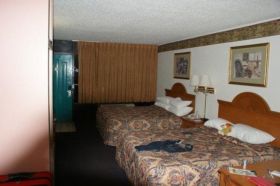 Days Inn & Suites by Wyndham Port Richey:                   View from the bathroom door.
