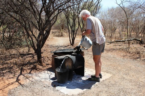 Mosetlha Bush Camp & Eco Lodge:                   Getting hot water for a shower
