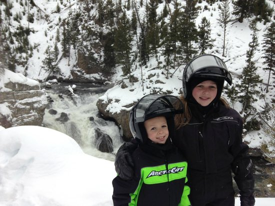 Back Country Snowmobile Adventures :                   Water fall in Yellowstone