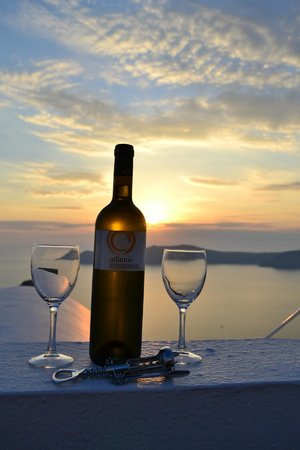 Astra Suites:                   Complimentary bottle of Santorini wine