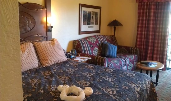 Boulder Ridge Villas at Disney's Wilderness Lodge:                   Bed and seating area with queen sleeper sofa