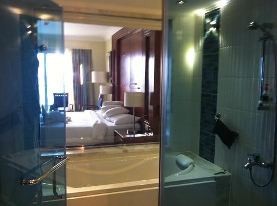 Xperience Sea Breeze Resort:                   bathroom thru bedroom