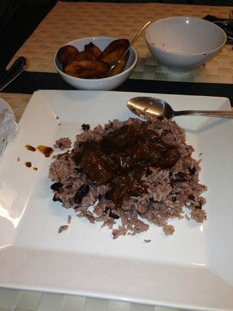 O-Tower Caribbean Cuisine: stew beef with rice and peas