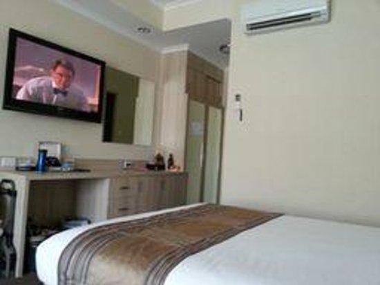 Best Western Plus Garden City Hotel :                   View of our room from lounge looking towards door.