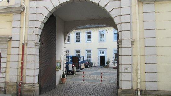 Kolpinghaus Warsberger Hof :                   The parking courtyard, with stakes