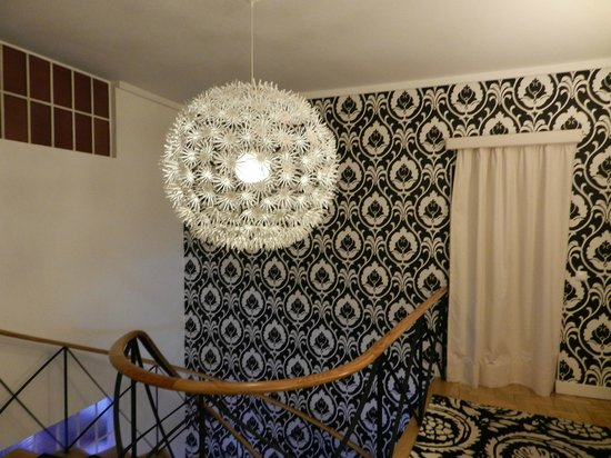 The House:                   Upstairs hallway - lovely light fixture!