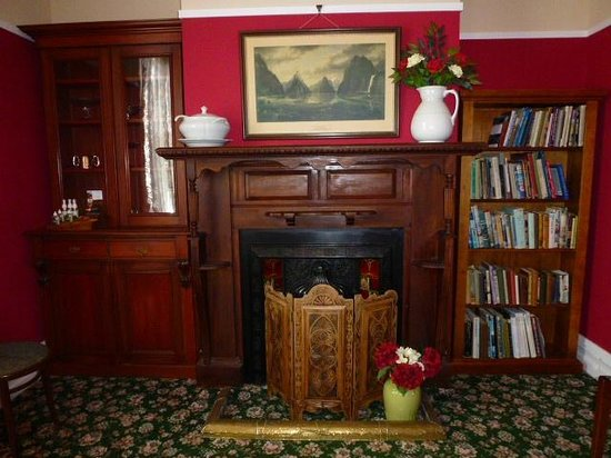 Murrell's Grand View House:                   Fireplace and historic photo of Milford Sound