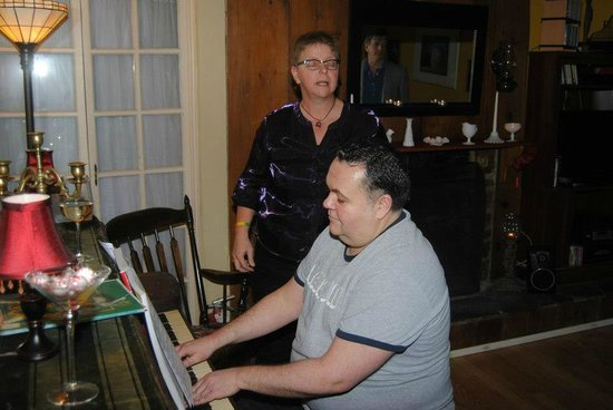 The Wishing Well Guesthouse :                   Michael the Innkeeper playing piano for the guests and singalong!
