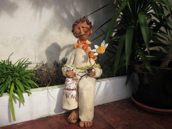 Casa do Bairro by Shiadu: This poor fellow guards the entrance