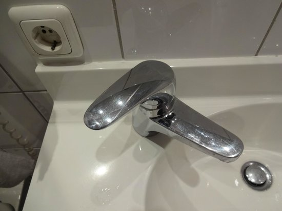 Hotelisssimo Haberstock:                   Bathroom sink faucet is on an angle but the lever is NOT, so this is the posit