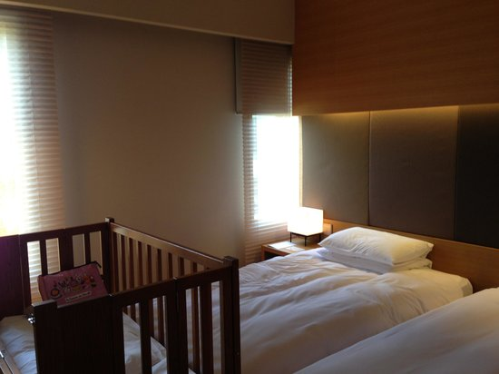 Hyatt Regency Kyoto:                                     Bed room with double beds and baby bed