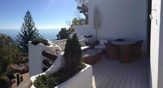 Marbella Club Hotel:                   Dinning and sofa area on the terrace